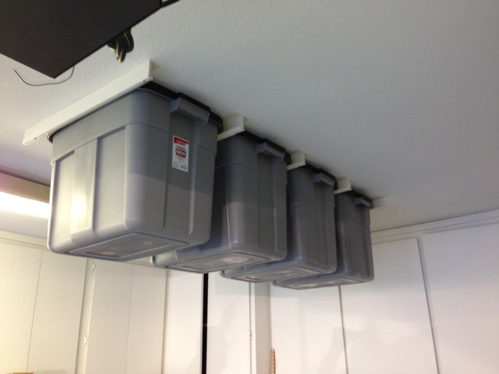 Bin Tracks Allow You To Hang Storage Totes From Garage Or