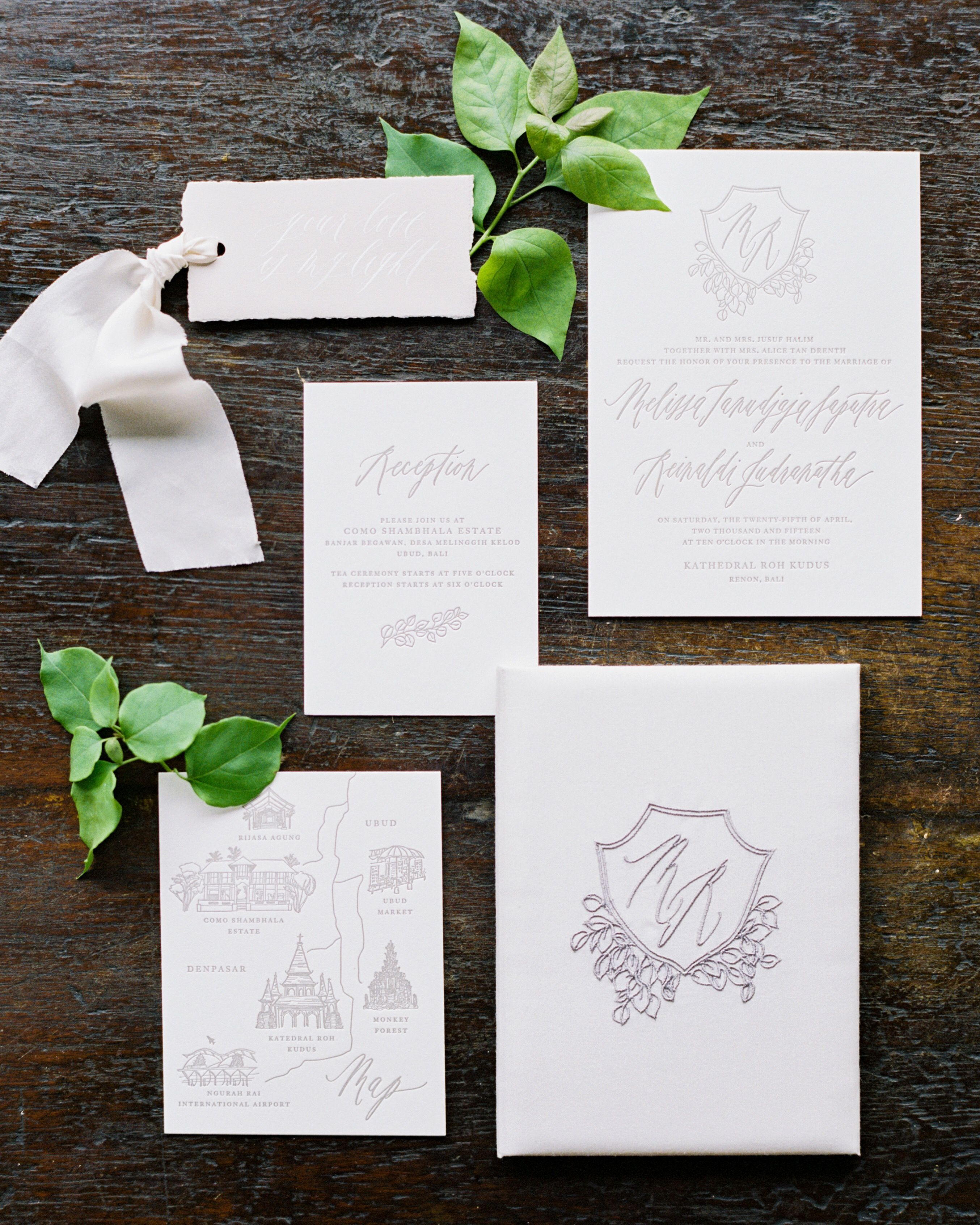 Silk folio invitations with embroidered monogram // calligraphy and ...