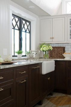Gorgeous Kitchen Features Light Grey Upper Cabinets And Dark Brown Lower Paired With Gray