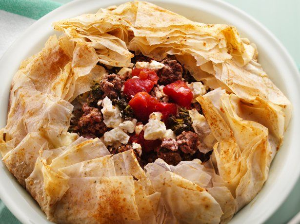 Flaky phyllo crust encases a savory ground beef filling flavored with spinach, tomatoes and feta cheese.