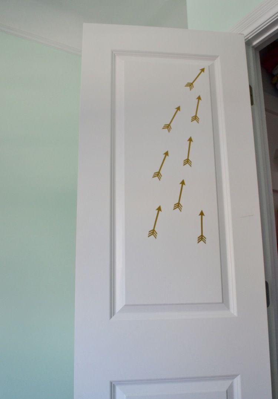 Gold Flying Arrow Wall Decals adorn the inside of the closet door ...