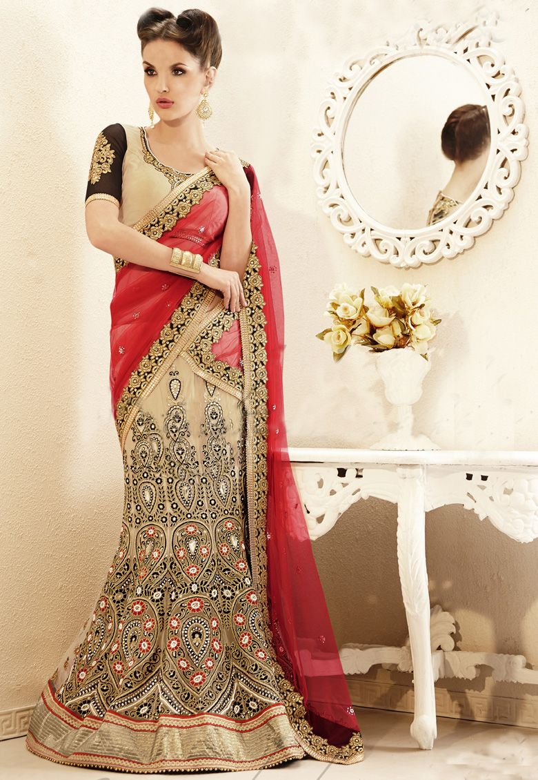 Biege and black and maroon net saree designed with threadzaripatch