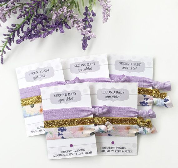 Hair ties make the perfect little take home gift for a baby shower, sprinkle, sip and see, or gender reveal party! Each favor includes: - (1) Favor card personalized with your own custom wording - (3) Hair ties: * Solid Lavender * Skinny Gold Glitter * Pastel Floral By Plum Polka Dot