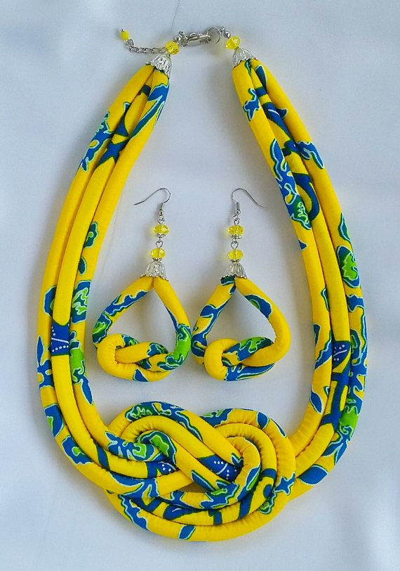 Yellow and Blue African print necklace with matching earrings designed to accent your look for any occasion. - The necklace is made of yellow and blue multi strand African wax print which is knotted beautifully to give you a unique look. - The earrings is also knotted with a #africanbeauty