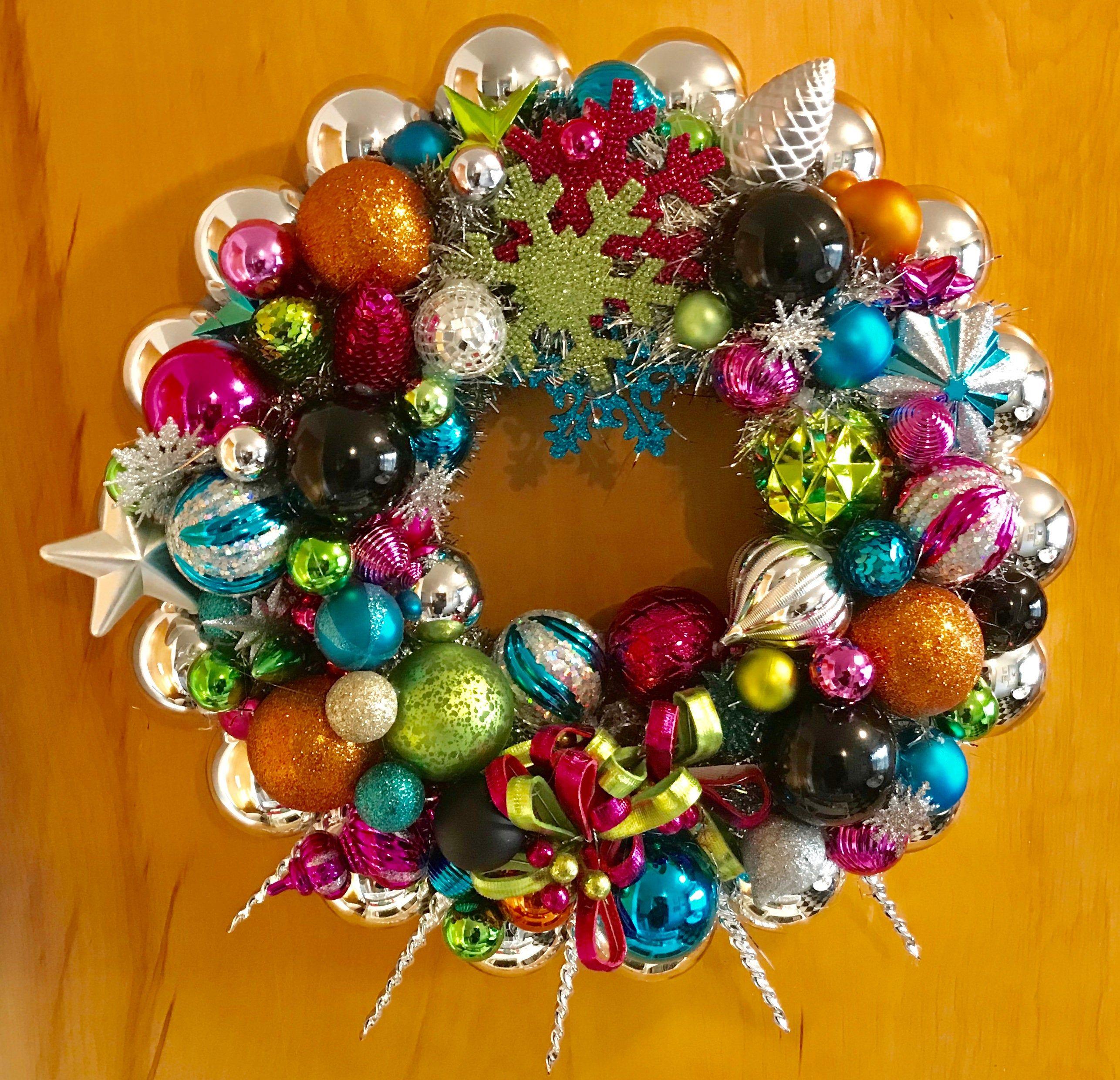 Photo of Christmas ornament wreath.  Mid century modern, Retro, kitschy, VIBRANT, cheerful designer wreath
