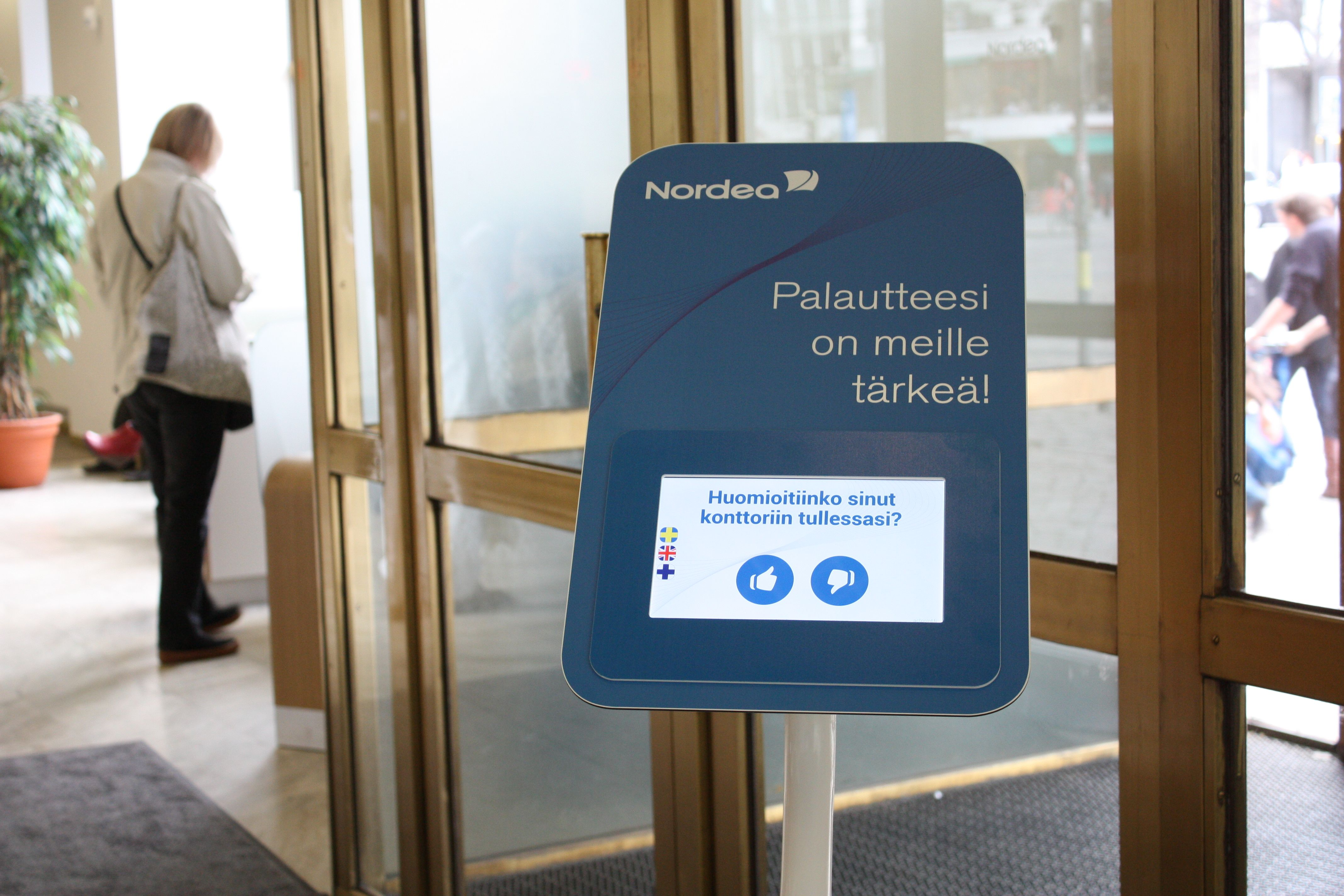 Nordea Bank Using Tablet Stand For Customer Satisfaction Survey