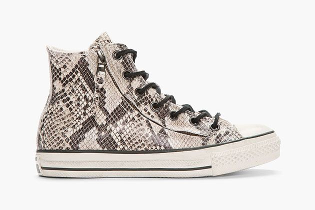 57780bad47b8 Converse and John Varvatos teamed up to release a grey and white snakeskin  textured high-top leather Chuck Taylor All Star sneaker.