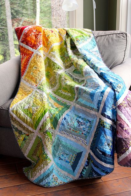 "Rainbow Scrappy String Quilt.  Made from various scraps & strings 2"" or less from my scraps. 59"" by 71"". I used the method in a tutorial at Film in the Fridge (found here: filminthefridge.com/2009/04/27/a-string-quilt-block-tutor...). Binding is Itty Bitty RicRac by LakeHouse Designs and backing is a sheet from Ikea. I pieced it with Aurifil 50 wt and machine quilted it as well with 50 wt, using a variegated rainbow thread for the bobbin and light gray for the top thread."