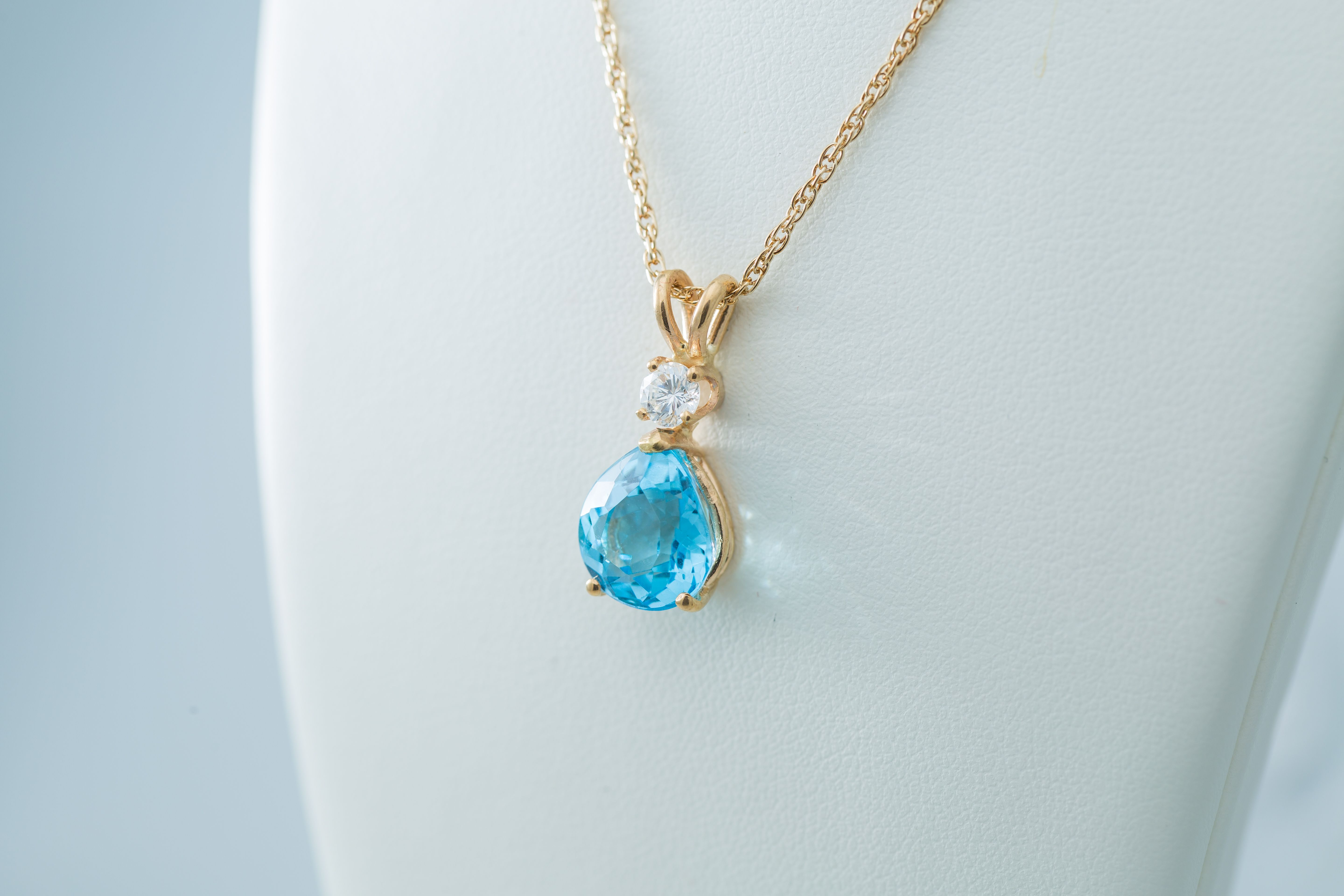 This stunning 4.19ct Blue Topaz in 14K Gold with .24ctw Diamond necklace would make a great gift for any occasion.  C.M. Buxton Jeweler & Rare Coins.  $750