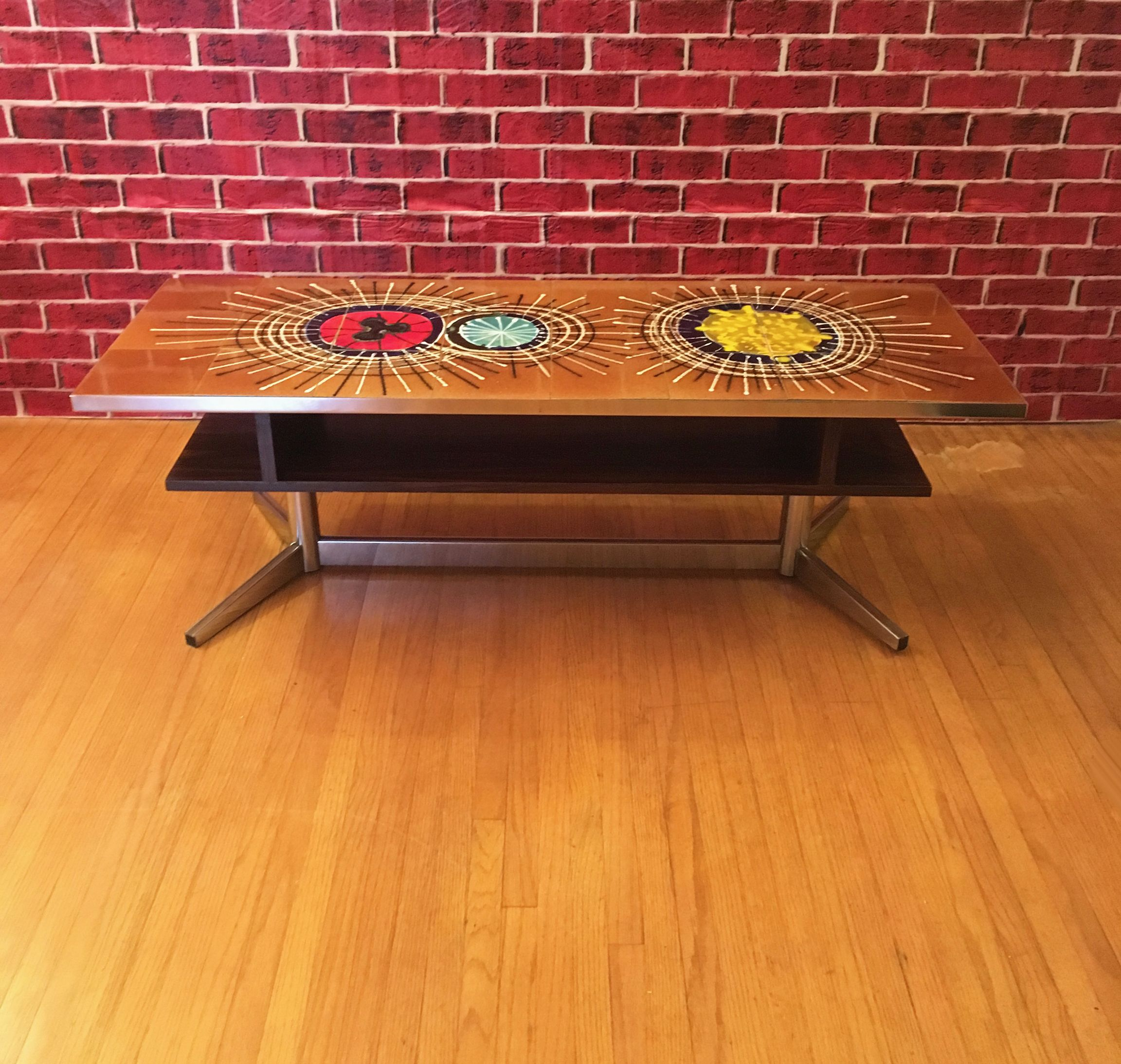 This rare and unique French Mid Century ceramic tile coffee table