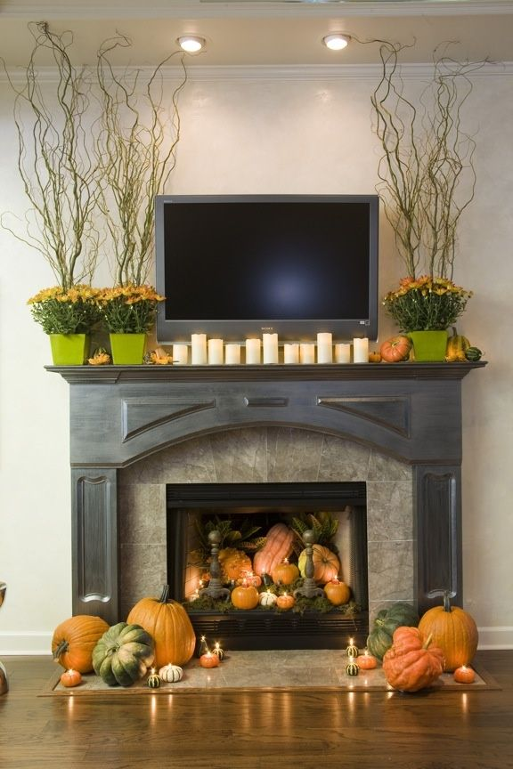 Perfect Halloween/Thanksgiving mantle decoration I like the plants