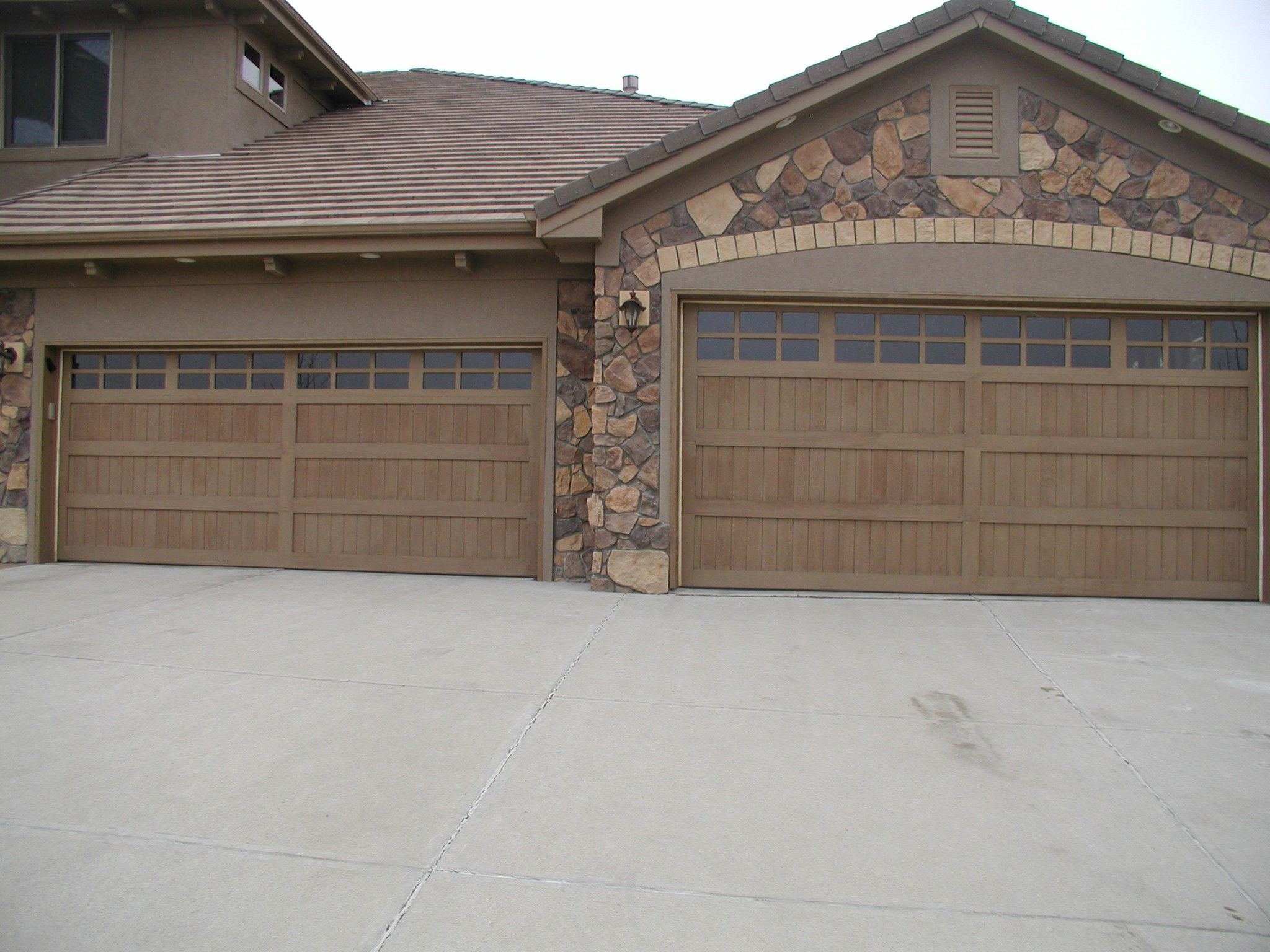 Wood Sided Doors By A And J Garage Doors Garage Pinterest