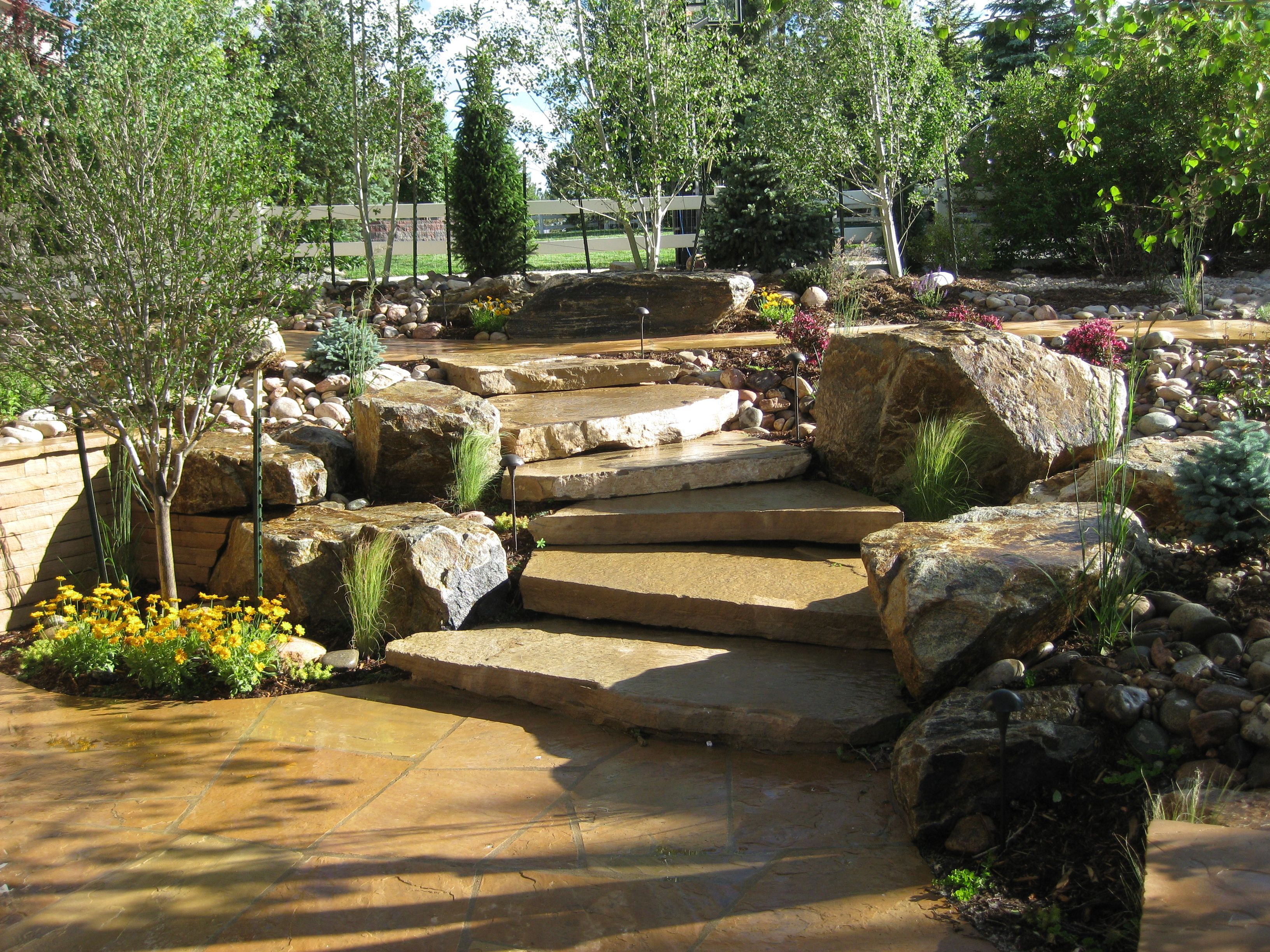 Landscaping steps pictures rustic flagstone patio with for Landscaping with rocks and boulders