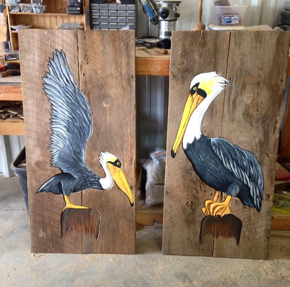 Handcarved And Painted Pelicans On Cypress Wood Background