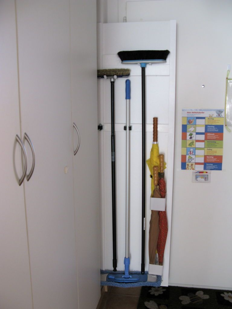 Organize Brooms Mops Umbrellas Etc On This Hidden Panel That Can Be Tucked The Side Of A Closet Or Fridge