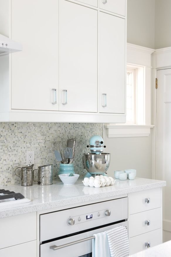 All White Kitchen Features White Ikea Kitchen Cabinets, Eco By Cosentino  White Diamond Countertops, Mosaic Tile Backsplash And Ikea Oven And  Turquoise Blue ...