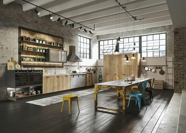 Stile industriale cucina open space con pareti in pietra mobili in