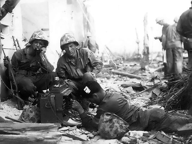 US Marine signalmen setting up a command post in the streets of Roi-Namur, Kwajalein, Marshall Islands, 1 Feb 1944