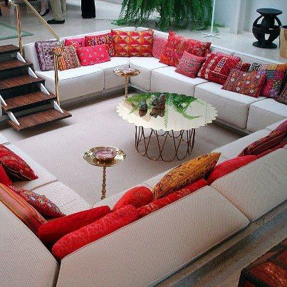 Sunken livingroom...love the idea of a whole room full of couch ...