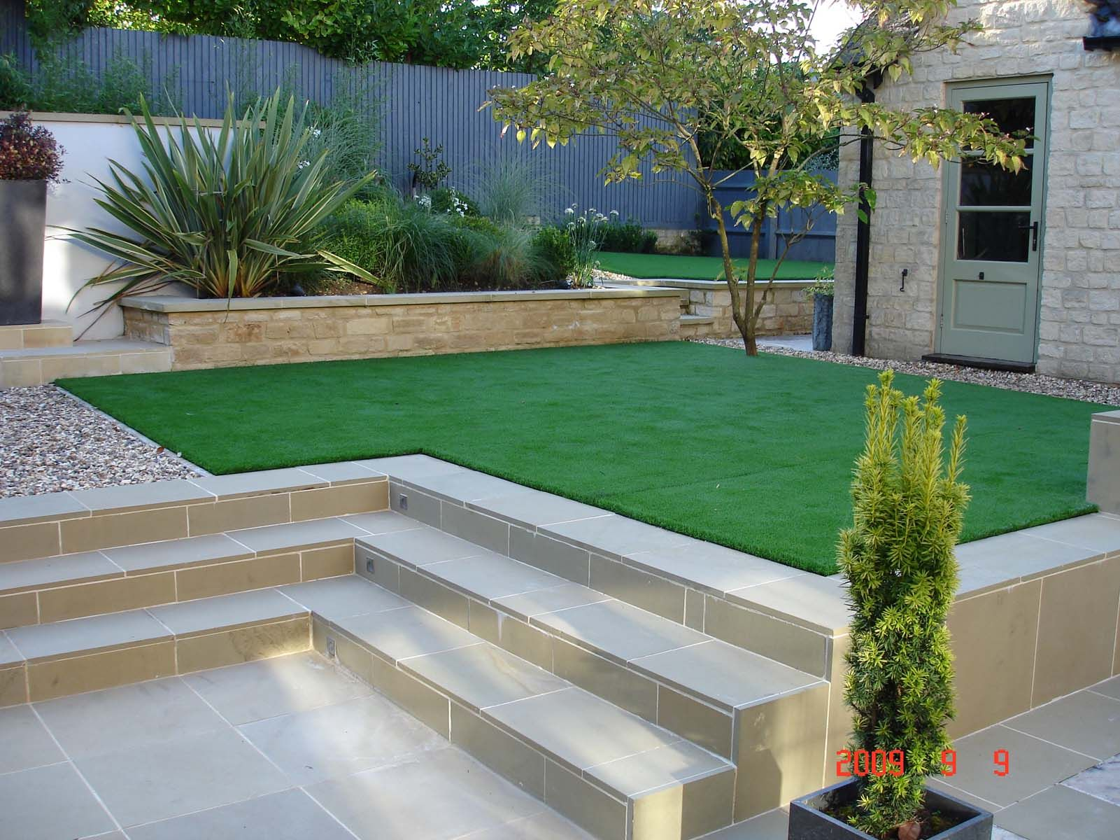Low maintenance with artificial grass astro turf garden for Contemporary garden design ideas