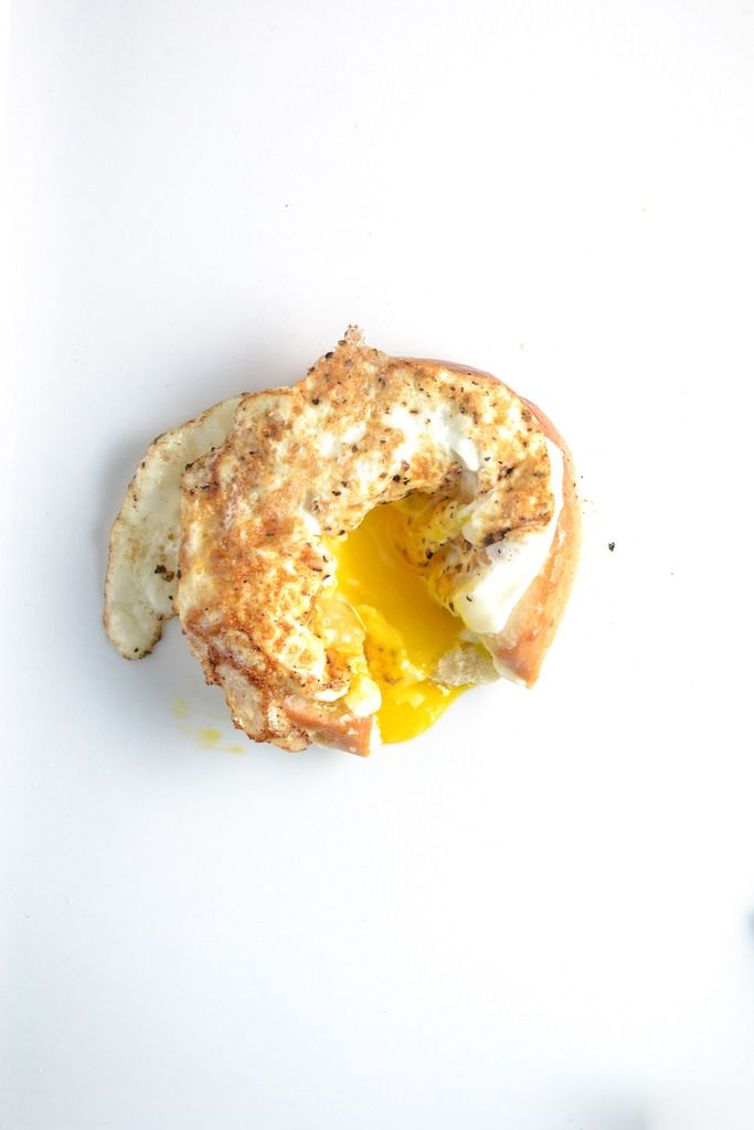 moonstruck is a bagel with an egg fried in the middle