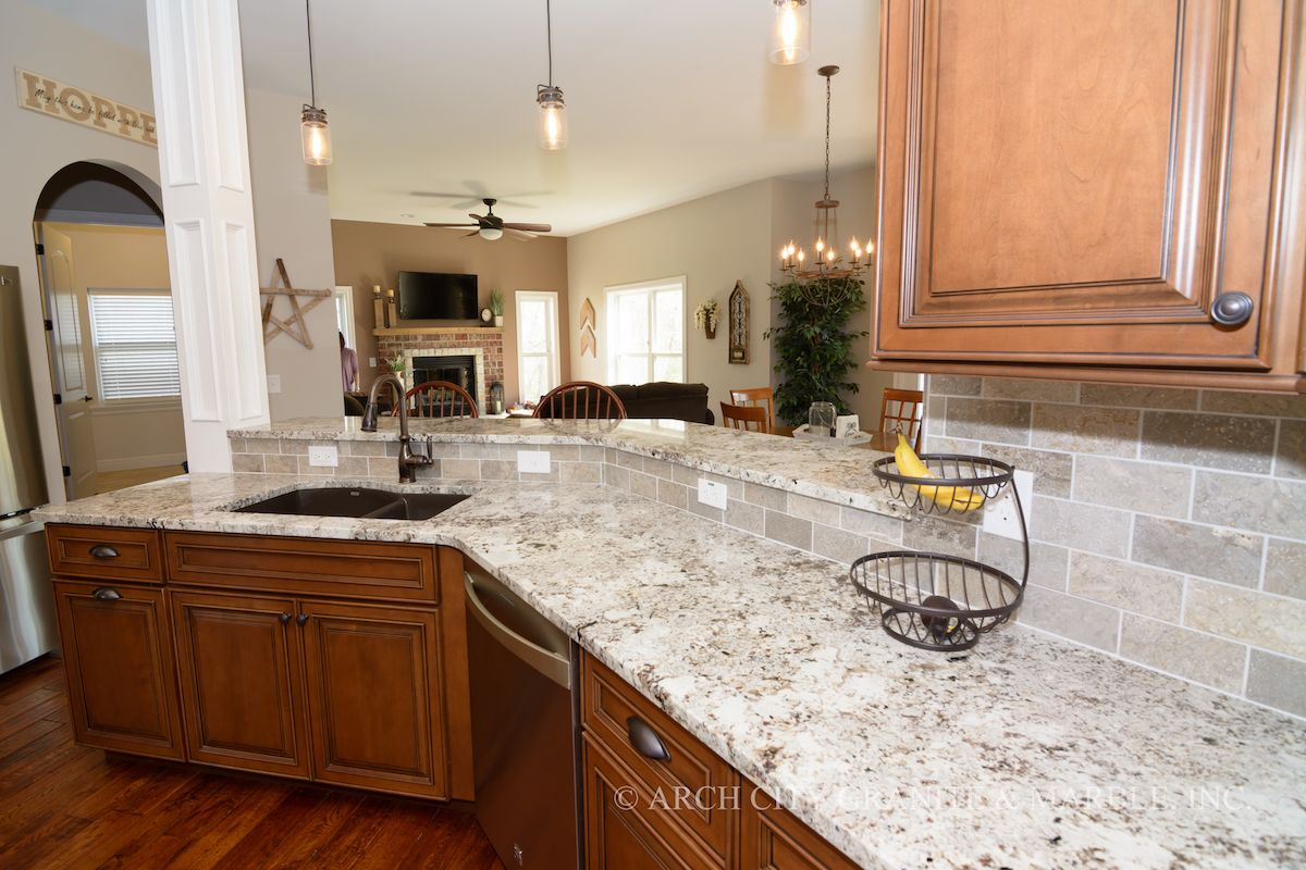 White granite color paired with medium maple and