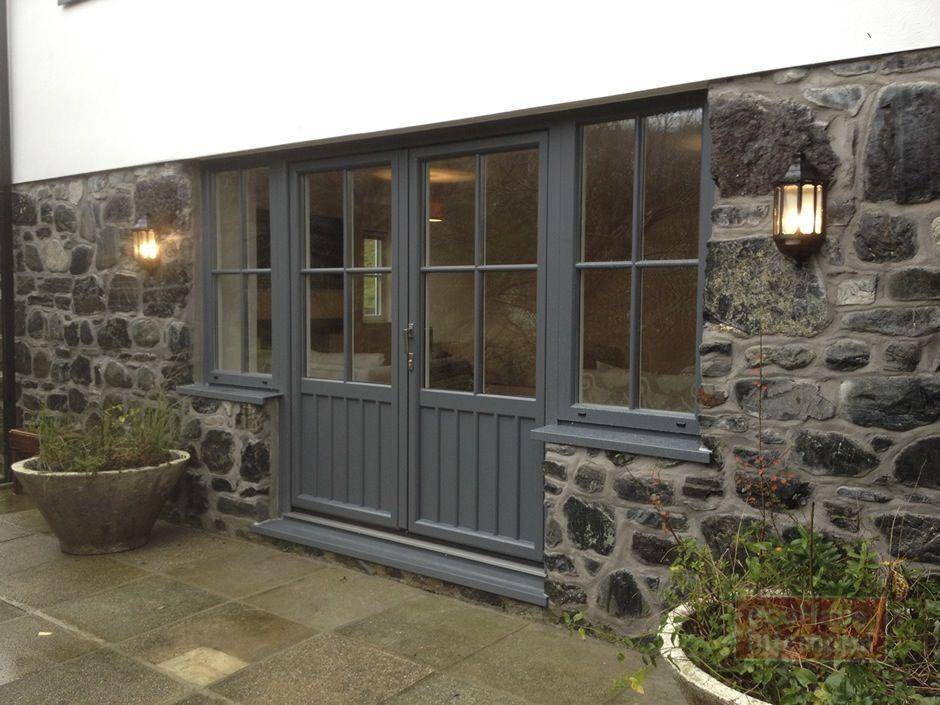 Back of the house grey aluminium windows and doors. A modern feel ...