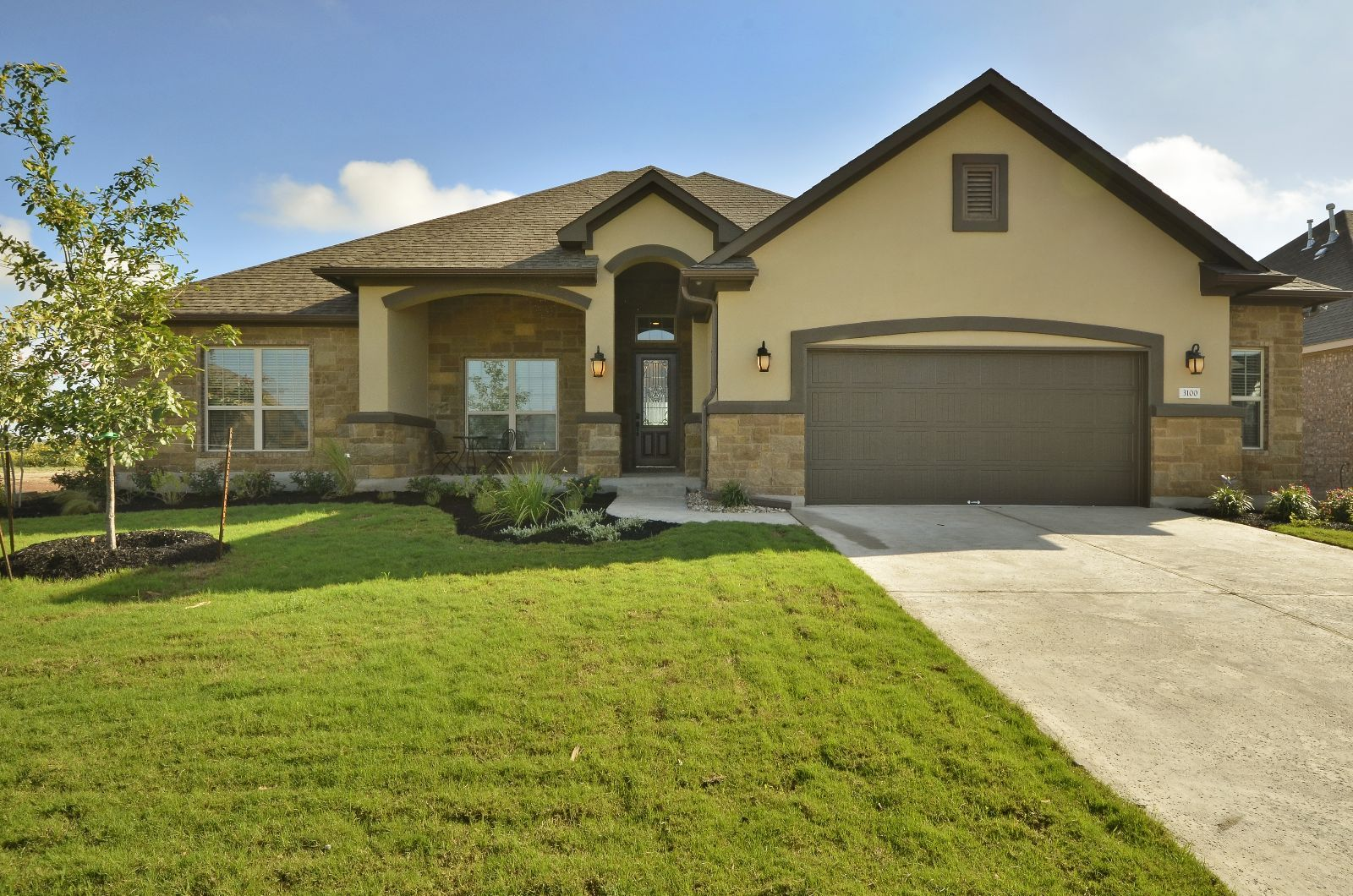 This custom one story ranch house plans features a for Stucco home plans