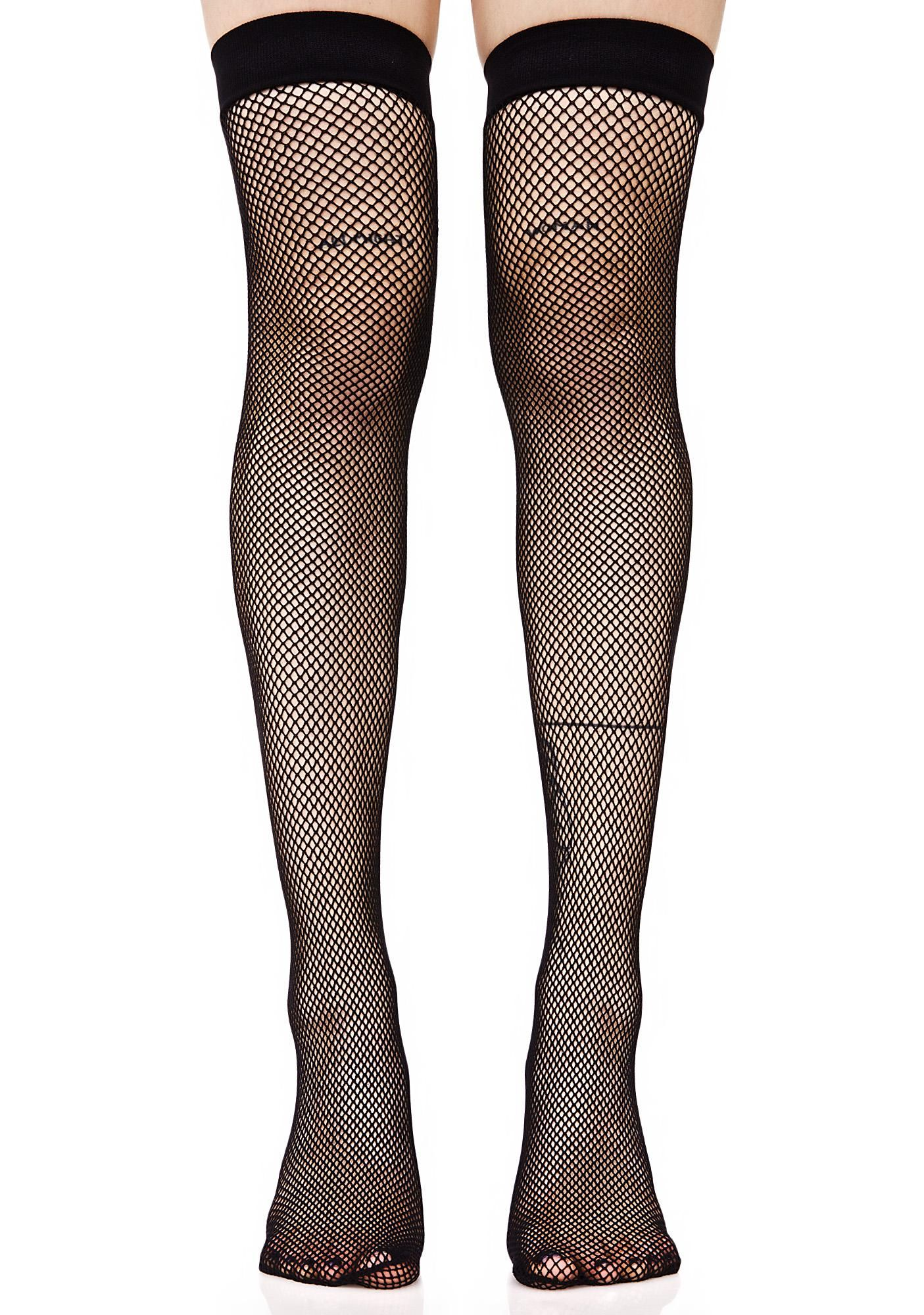d2bbf86f1 Stunt on  em in these fishnet thigh highs that feature a black stretchy  nylon construction that hits yer legs above the ...
