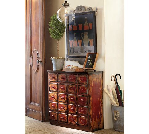 This is pottery barn, but I would love to find an old card catalogue to refurbish as entry furniture