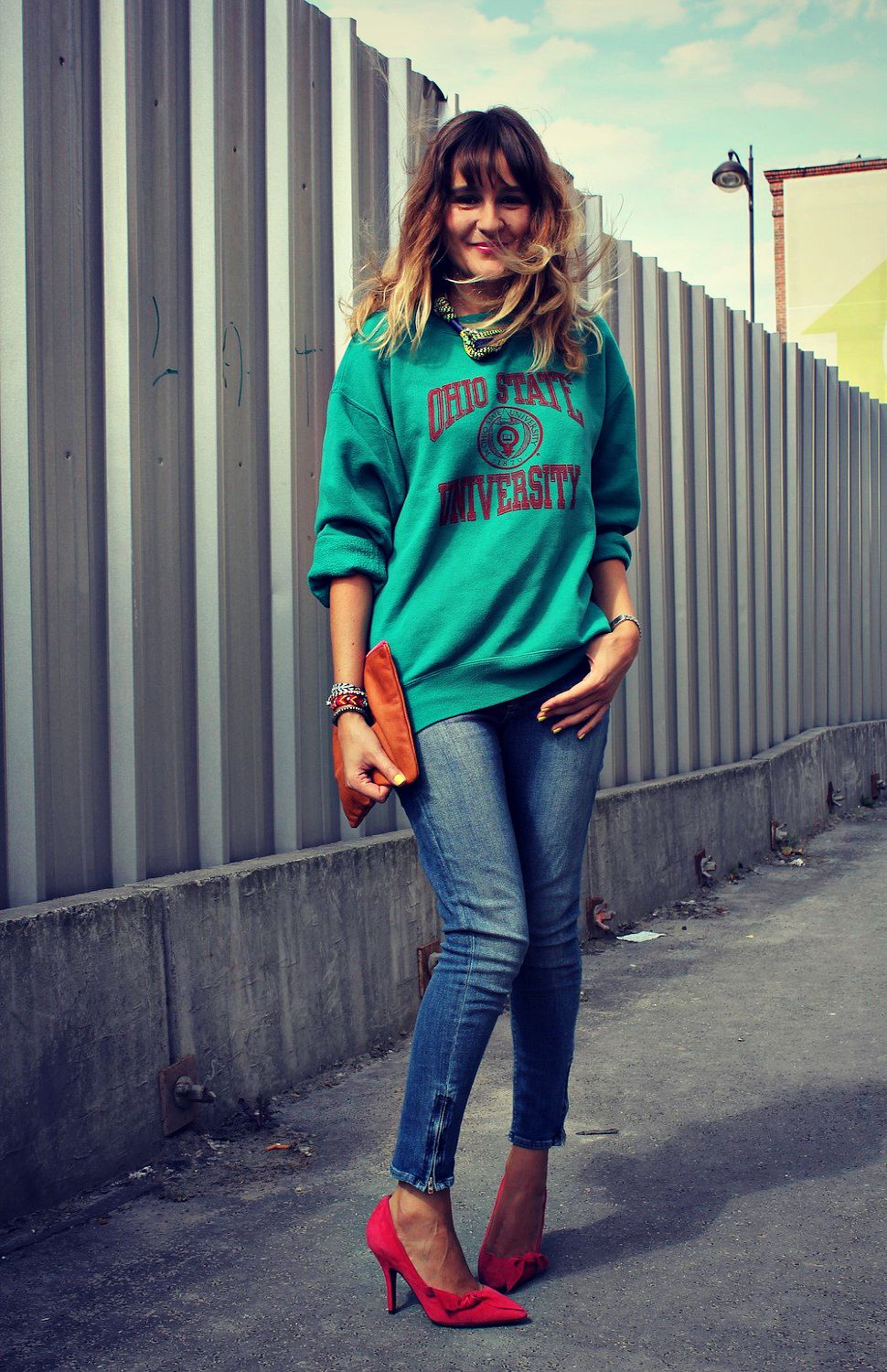 6a0b5441123 Dress up a vintage sweatshirt with skinny jeans and heels.
