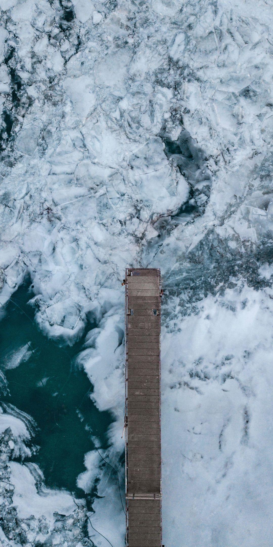 Frozen river, wooden dock, aerial view, 1080x2160