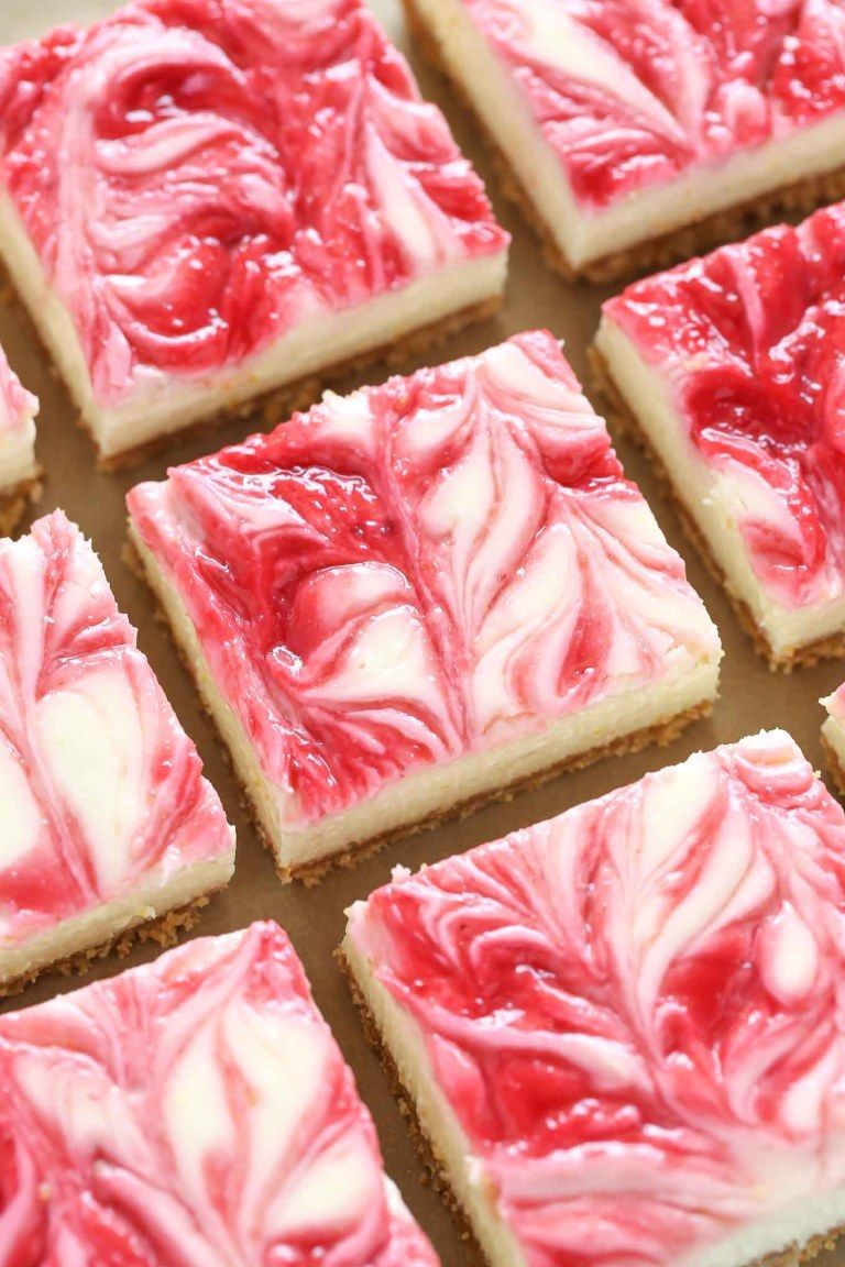 These Lemon Raspberry Cheesecake Bars feature a smooth and creamy lemon cheesecake filling with a raspberry swirl topped on a homemade graham cracker crust. #homemadegrahamcrackercrust These Lemon Raspberry Cheesecake Bars feature a smooth and creamy lemon cheesecake filling with a raspberry swirl topped on a homemade graham cracker crust. #homemadegrahamcrackercrust
