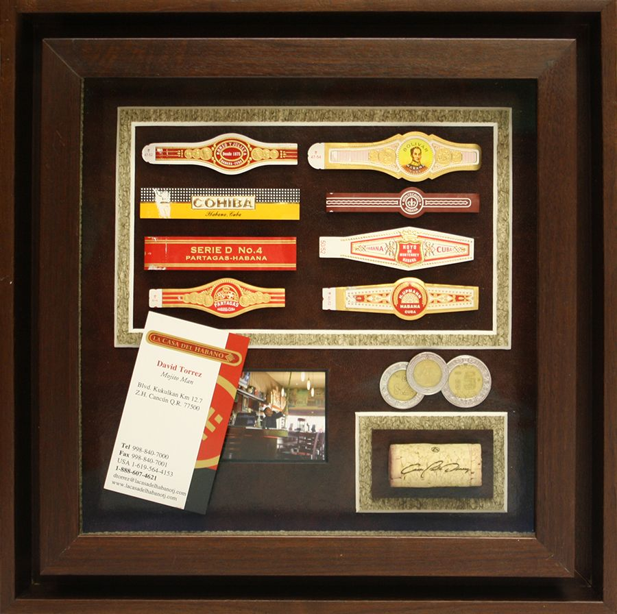 Custom shadowbox collage for cigar enthusiast with a rich wooden frame and cork textured mat boards.  What are you passionate about? Get it framed at Art & Frame Express.