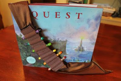 Homemade crayon sash/holder/bandolier for QUEST by Aaron Becker