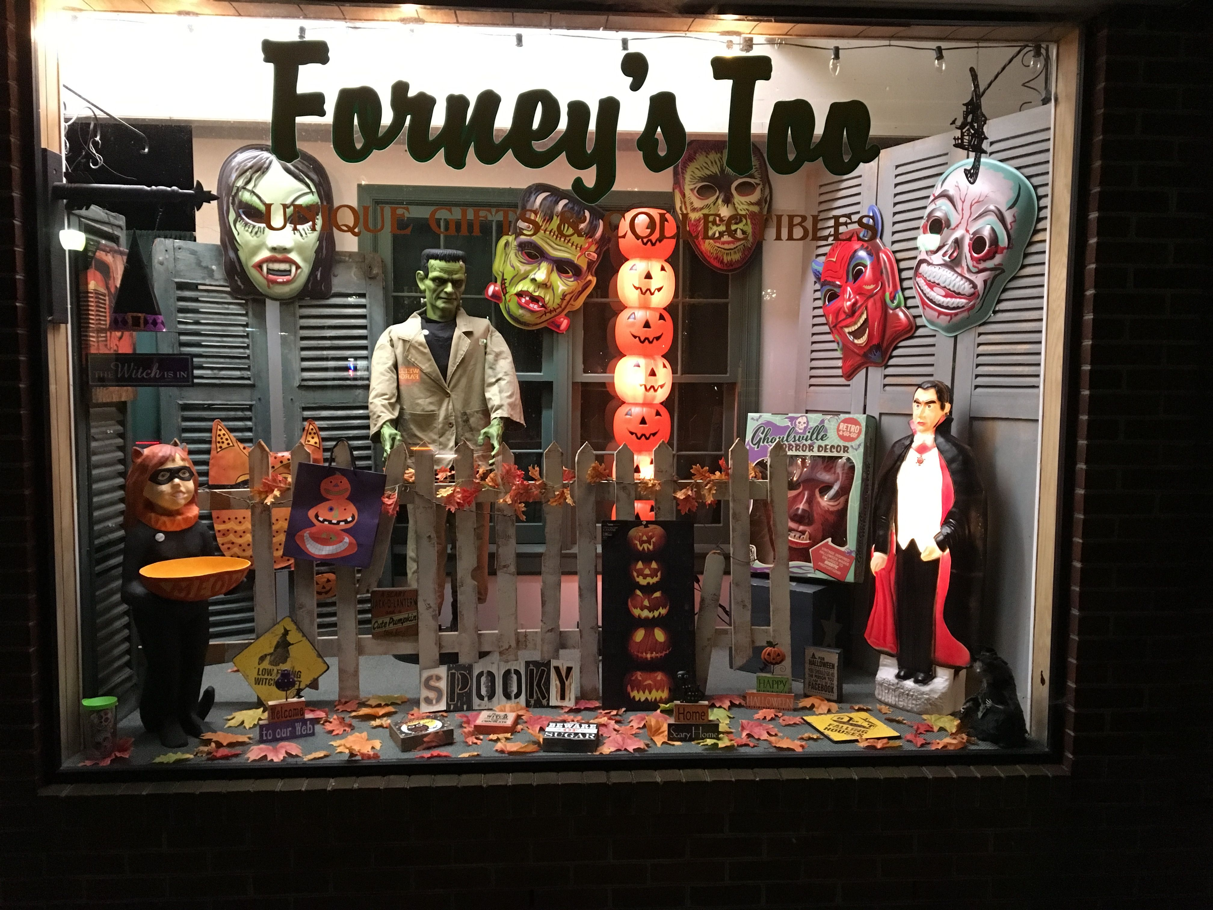 Check Out This Spooky Store Front Window Featuring Retro A Go Go Ghoooooolsville Masks Retro Halloween Halloween Wall Decor Vintage Halloween