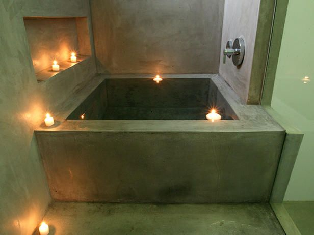 Floating candles and a mirror turn this monochromatic tub into the perfect place for a sexy soak.