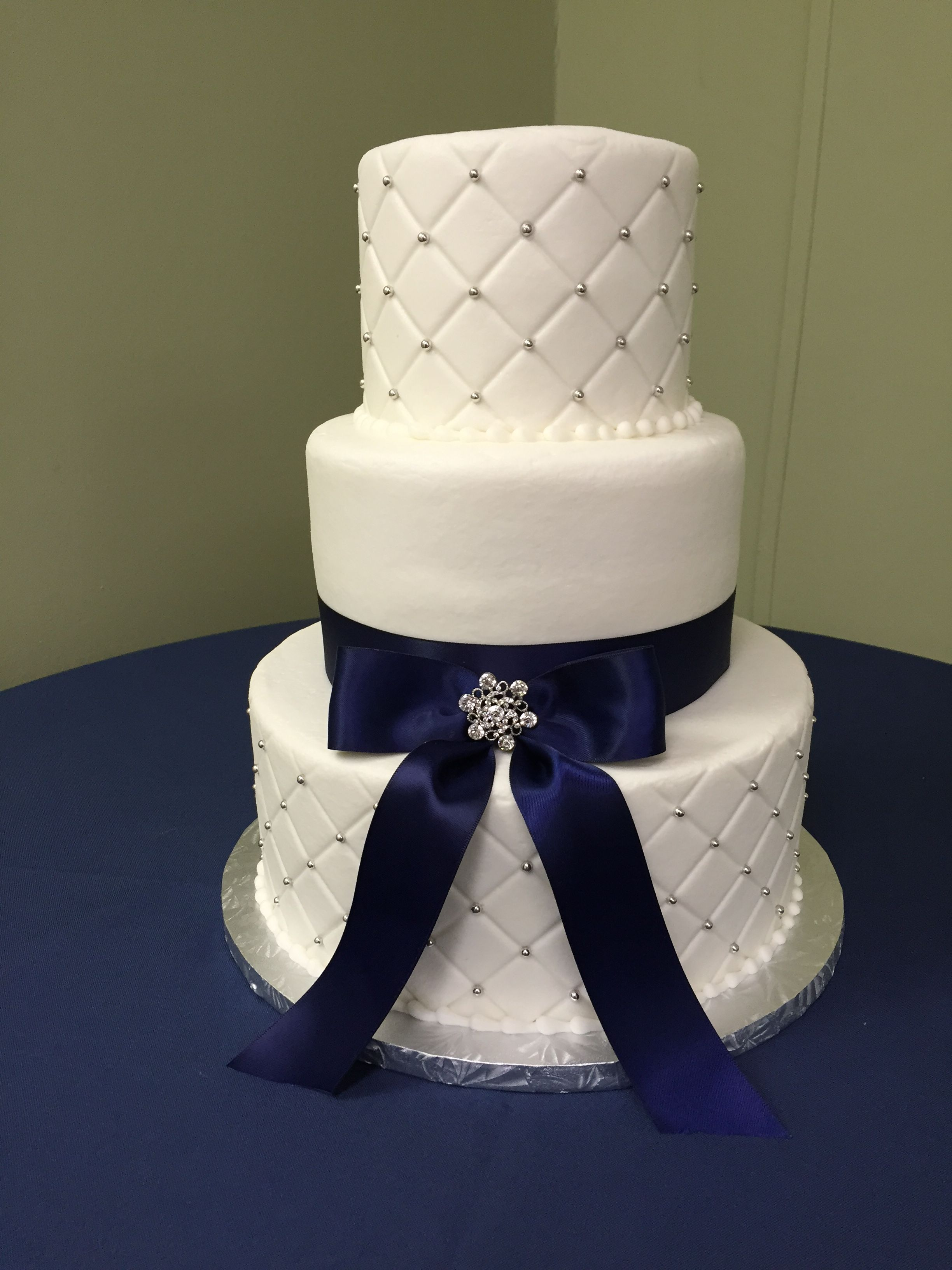 Cute 3 Tier Round Wedding Cake With Navy Blue Bow And