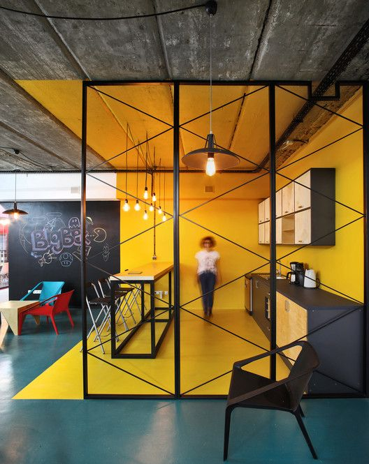 BigBek Office / SNKH Architectural Studio RW - Stunning in every way.  Use Color To Define An Area // In this kitchen within an office, bright yellow walls, floor and ceiling clearly defines the area.