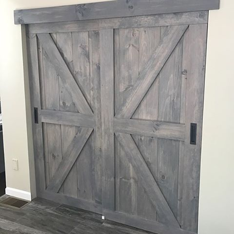 Two Of Our British Brace With Border Barn Doors Stained In Minwax Classic Grey Look Amazing As Bypass Pant Custom Barn Doors Bifold Barn Doors Old Barn Doors