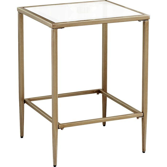 A glamorous mix of clear tempered glass and gold-finished metal, this side table offers a look that's both airy and luxe.