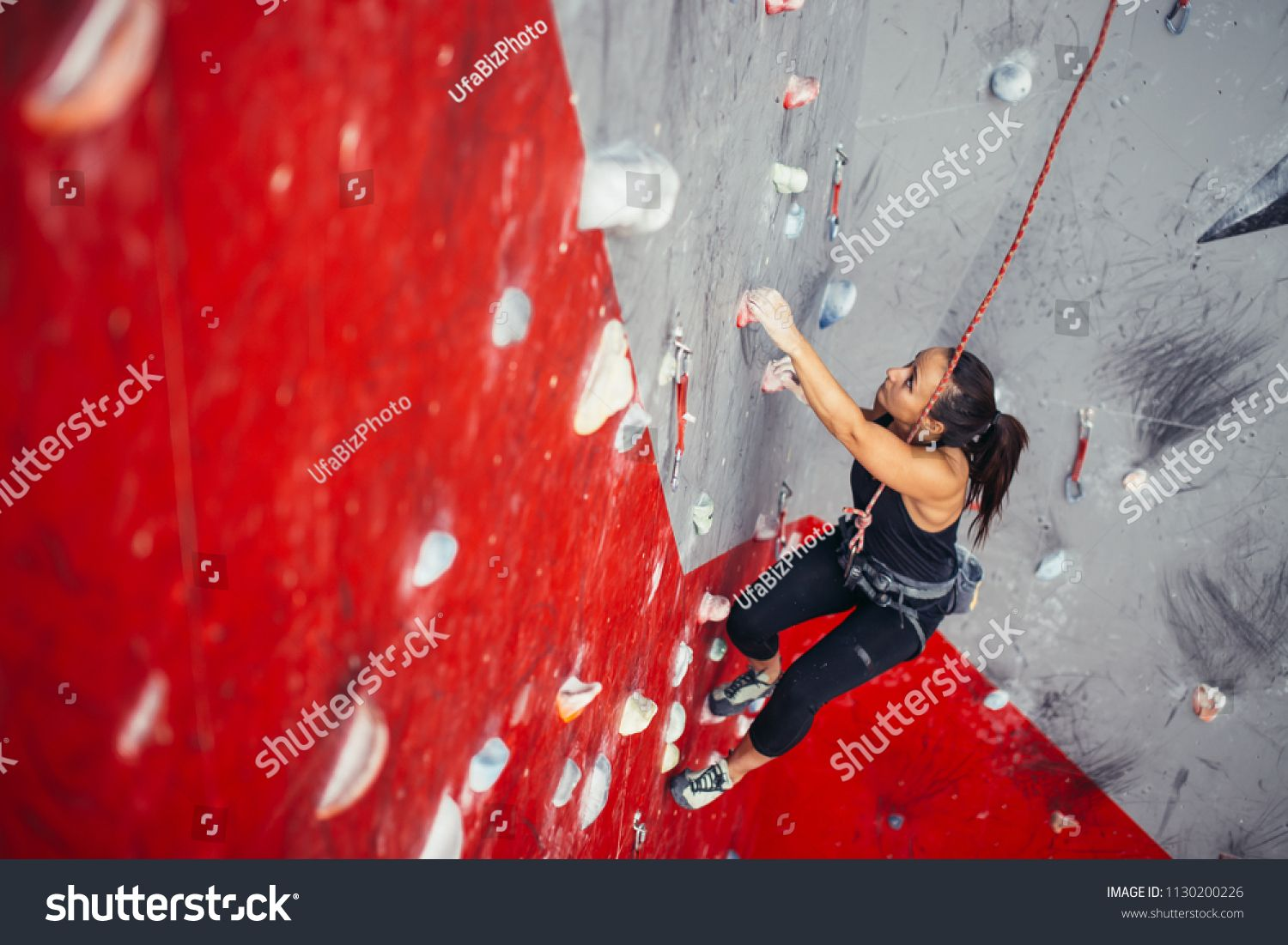 Young fitness woman doing professional bouldering in climbing gym indoors #Ad , #Affiliate, #woman#p...