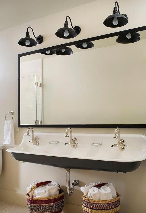 gorgeous kids bathroom featuring a gray kohler brockway