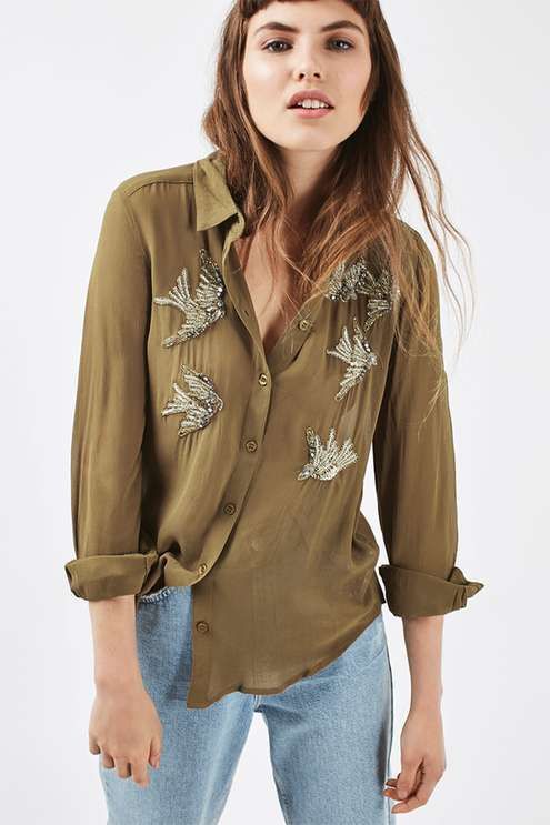 Refresh your shirt collection with this pretty embellished piece, featuring beaded and sequin swallow embroidery to the front. In an autumnal olive hue, wear tucked out of boyfriend jeans for a relaxed look. #Topshop