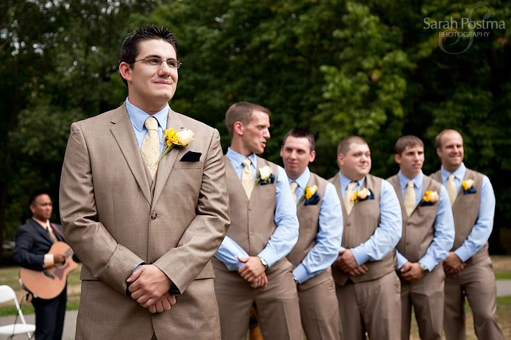 Tan Suits With Groomsman In Blue Shirts And Vests