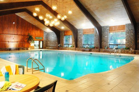 Indoor And Outdoor Swimming Pools And Hot Tubs Peek N Peak Swimming Pools Outdoor Swimming Pool Hot Tub Outdoor