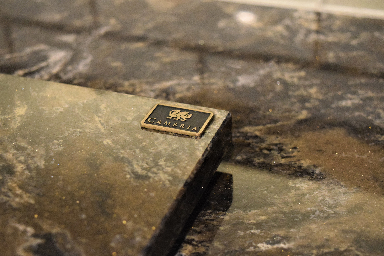 The foyer features a custom-cut Cambria quartz floor with ... |Cambria Quartz Hampshire Mill Carpet