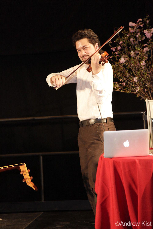 Musician Kenji Williams in the Bella Gaia performance