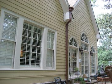 Tan Exterior With White Trim And Dark Brown Gutters Exterior House Colors Traditional Exterior Gutters