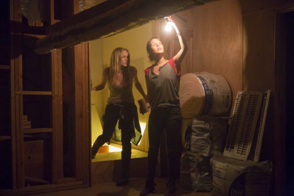 Caity Lotz and Camilla Luddington in The Pact II (2014) Great sequel